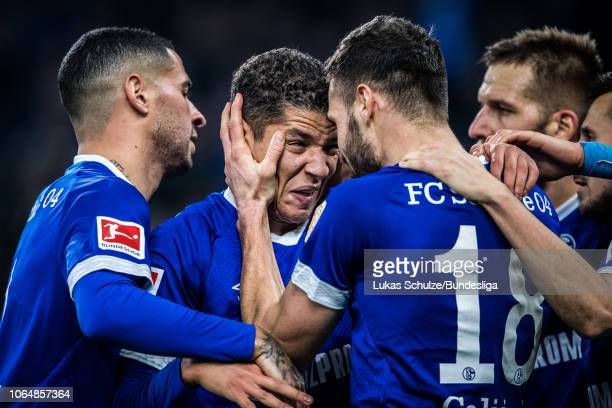 Amine Harit of Schalke celebrates his teams fourth goal with teammates during the Bundesliga match between FC Schalke 04 and 1 FC Nuernberg at...