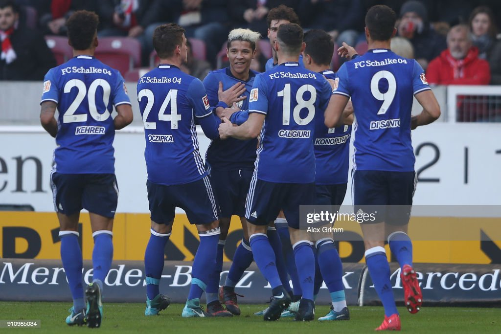 Amine Harit of Schalke (3L) celebrates his team's second goal with team mates during the Bundesliga match between VfB Stuttgart and FC Schalke 04 at Mercedes-Benz Arena on January 27, 2018 in Stuttgart, Germany.