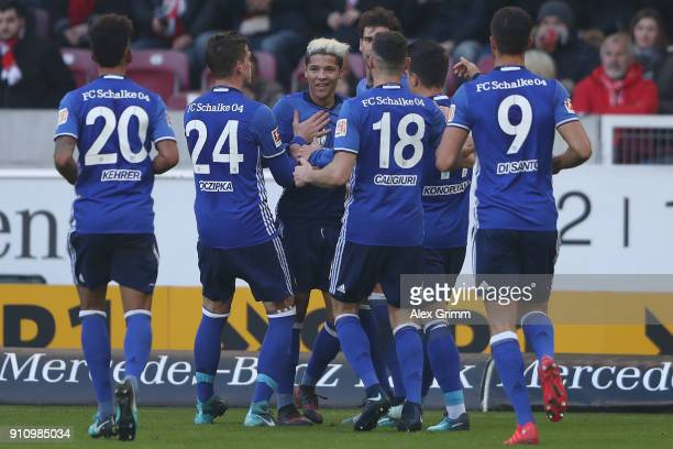 Amine Harit of Schalke celebrates his team's second goal with team mates during the Bundesliga match between VfB Stuttgart and FC Schalke 04 at...