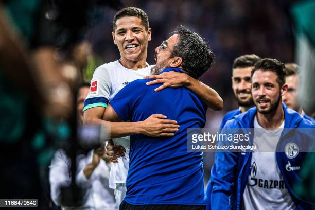 Amine Harit of Schalke celebrates his team's third goal with Head Coach David Wagner during the Bundesliga match between SC Paderborn 07 and FC...