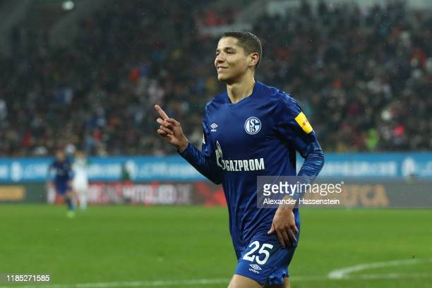 Amine Harit of Schalke celebrates scoring the 3rd team goal during the Bundesliga match between FC Augsburg and FC Schalke 04 at WWKArena on November...