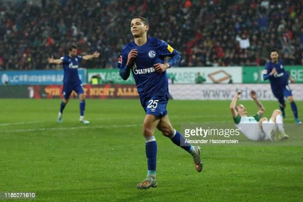 Amine Harit of Schalke celebrates scoring the 3rd team goal during the Bundesliga match between FC Augsburg and FC Schalke 04 at WWK-Arena on...