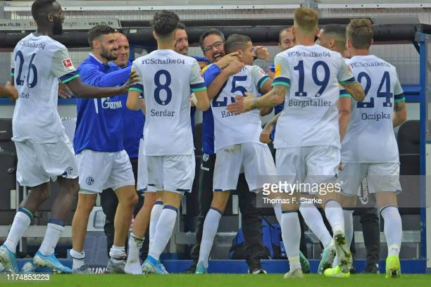 Amine Harit of Schalke celebrates with head coach David Wagner of Schalke after scoring his teams third goal during the Bundesliga match between SC...