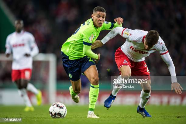Amine Harit of Schalke challenges for the ball with Salih Oezcan of Koeln during the DFB Cup match between 1 FC Koeln and FC Schalke 04 at...
