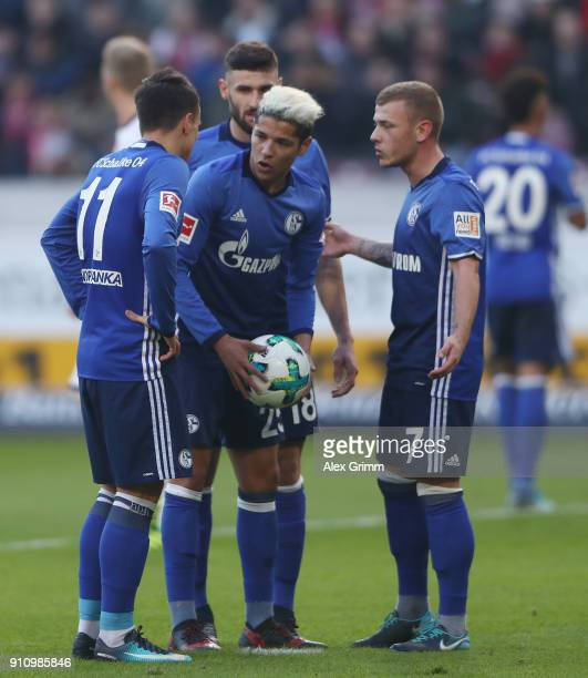 Amine Harit of Schalke discusses with team mates Evgen Konoplyanka and Max Meyer before shooting a penalty during the Bundesliga match between VfB...