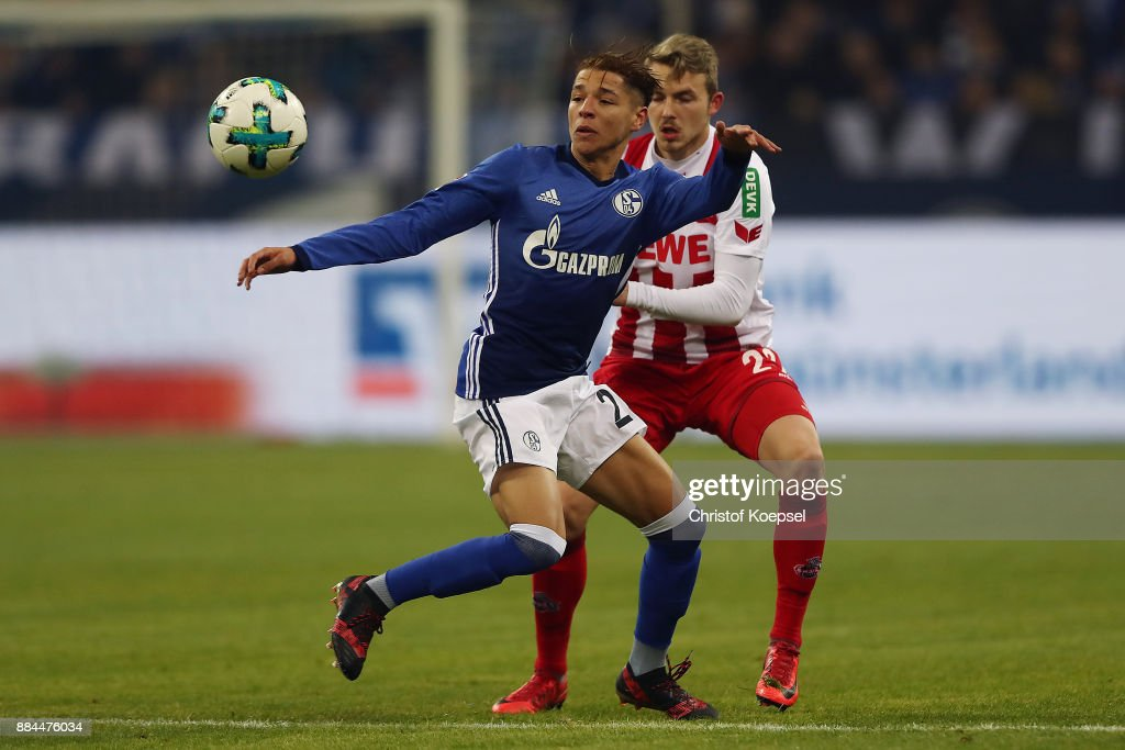 Amine Harit of Schalke (9) fights for the ball with Jannes Horn of Koeln during the Bundesliga match between FC Schalke 04 and 1. FC Koeln at Veltins-Arena on December 2, 2017 in Gelsenkirchen, Germany.