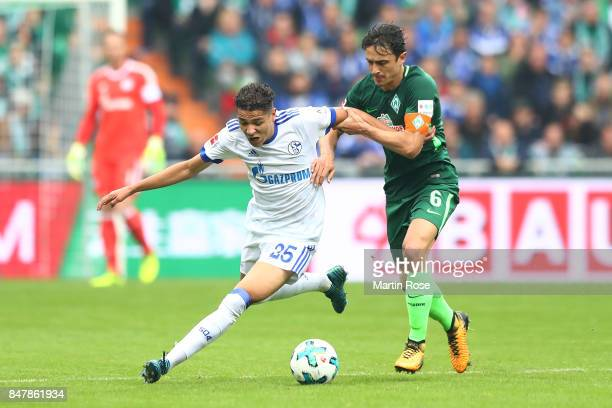 Amine Harit of Schalke fights for the ball with Thomas Delaney of Bremen during the Bundesliga match between SV Werder Bremen and FC Schalke 04 at...