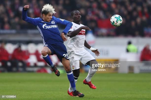 Amine Harit of Schalke is challenged by Chadrac Akolo of Stuttgart during the Bundesliga match between VfB Stuttgart and FC Schalke 04 at...