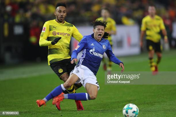Amine Harit of Schalke is fouled by PierreEmerick Aubameyang of Dortmund which results in a red card during the Bundesliga match between Borussia...