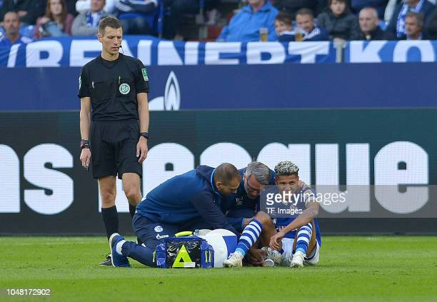 Amine Harit of Schalke is injured during the Bundesliga match between FC Schalke 04 and 1 FSV Mainz 05 at VeltinsArena on September 29 2018 in...