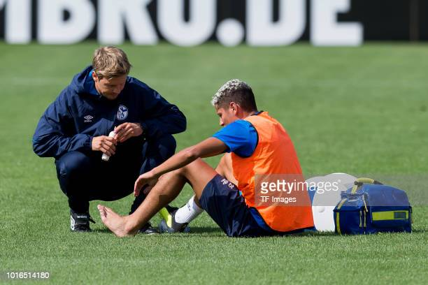 Amine Harit of Schalke is injured during the Schalke 04 training session on August 14 2018 in Gelsenkirchen Germany