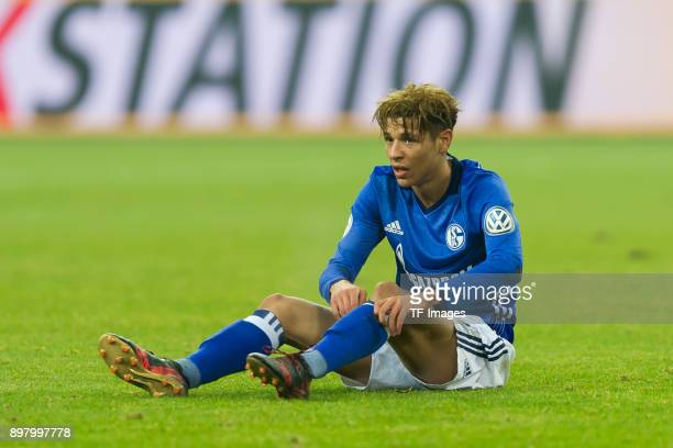 Amine Harit of Schalke on the ground during the DFB Cup match between FC Schalke 04 and 1 FC Koeln at VeltinsArena on December 19 2017 in...