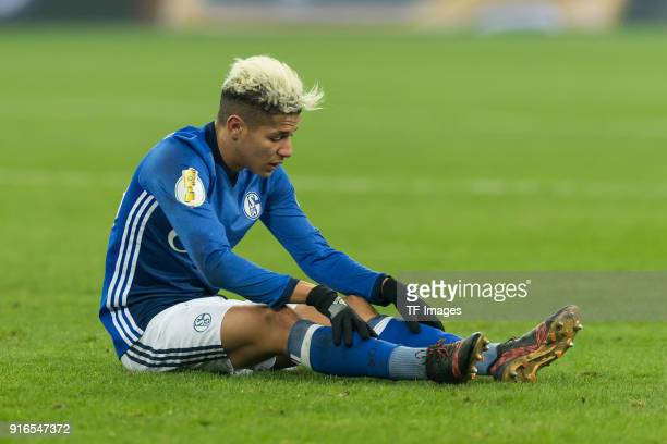 Amine Harit of Schalke on the ground during the DFB Cup match between FC Schalke 04 and VfL Wolfsburg at VeltinsArena on February 7 2018 in...