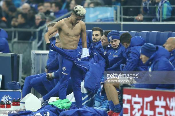 Amine Harit of Schalke prepares to come on as a substitute during the Bundesliga match between FC Schalke 04 and TSG 1899 Hoffenheim at VeltinsArena...