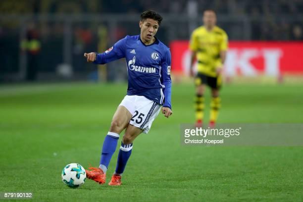 Amine Harit of Schalke runs with the ball during the Bundesliga match between Borussia Dortmund and FC Schalke 04 at Signal Iduna Park on November 25...