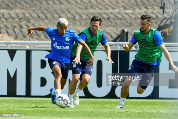 Amine Harit of Schalke Sascha Riether of Schalke and Steven Skrzybski of Schalke battle for the ball during a training session at the FC Schalke 04...