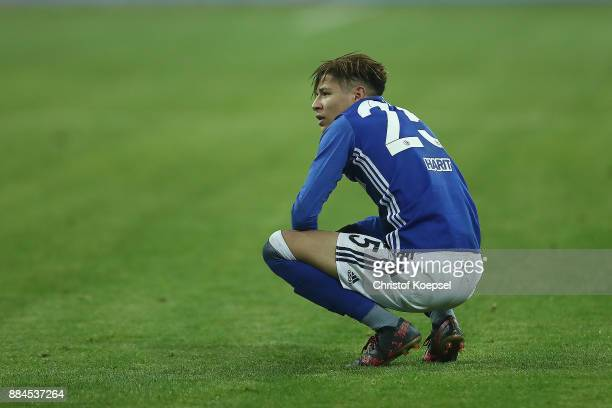 Amine Harit of Schalke sits on the pitch dejected after the Bundesliga match between FC Schalke 04 and 1 FC Koeln at VeltinsArena on December 2 2017...