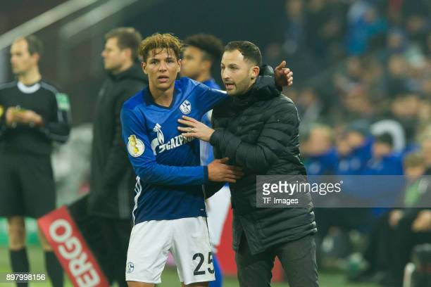 Amine Harit of Schalke speaks with Head coach Domenico Tedesco of Schalke during the DFB Cup match between FC Schalke 04 and 1 FC Koeln at...