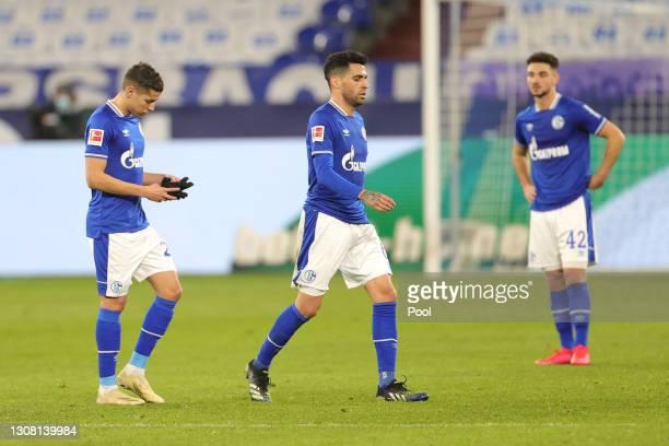 Amine Harit, Omar Mascarell and Kerim Calhanoglu of FC Schalke 04 look dejected after the Bundesliga match between FC Schalke 04 and Borussia...