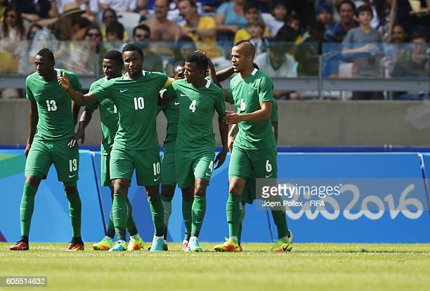 Aminu Umar of Nigeria celebrates with his team mates after scoring his team's second goal during the Men's Olympic Football Bronze Medal match...