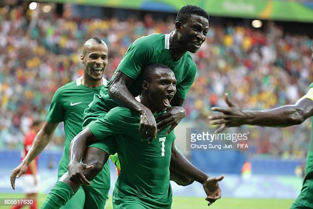Aminu Umar of Nigeria celebrates with team mates after scoring a goal during the Men's Football Quarter Final match between Nigeria and Denmark on...
