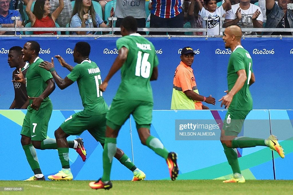 Aminu Umar (L) of Nigeria celebrates with teammates after scoring against Denmark during the Rio 2016 Olympic Games mens quarter-final football match Nigeria vs Denmark, at the Arena Fonte Nova Stadium in Salvador, Brazil on August 13, 2016. / AFP / NELSON