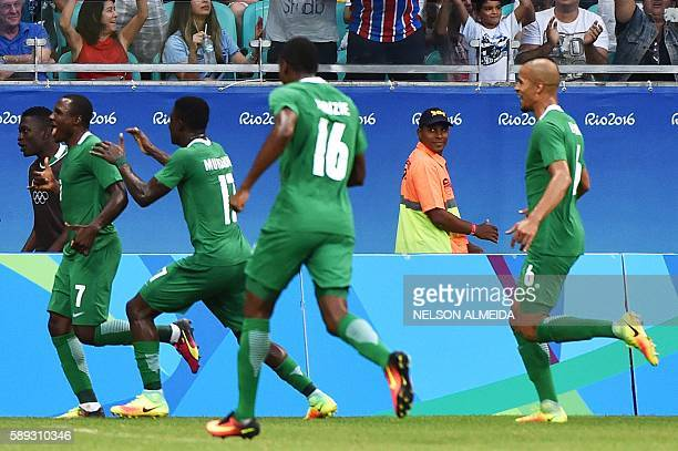 Aminu Umar of Nigeria celebrates with teammates after scoring against Denmark during the Rio 2016 Olympic Games mens quarterfinal football match...