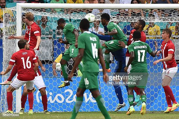 Aminu Umar of Nigeria heads the ball to score against Denmark during the Rio 2016 Olympic Games mens quarterfinal football match Nigeria vs Denmark...