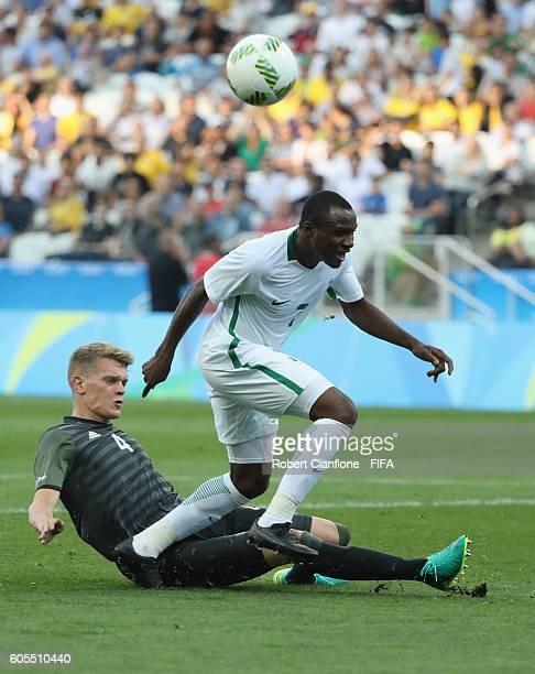 Aminu Umar of Nigeria is challenged by Matthias Ginter of Germany during the Men's Football Semi Final between Nigeria and Germany on Day 12 of the...