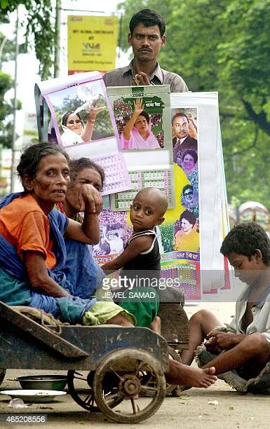 Aminul Islam an unemployed man hawks posters of Bangladesh former prime minister Sheikh Hasina Wajed of the Awami League and former opposition leader...