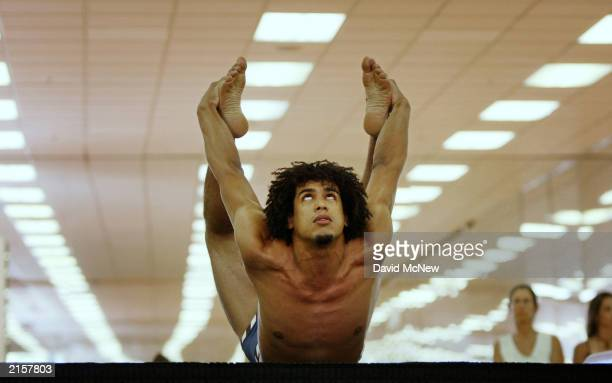 Amir AbdulJabbar son of former basketball star Kareem AbdulJabbar competes in the semifinal round of the 2003 International Yoga ChampionshipGhosh...