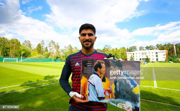 Amir Abedzadeh shows a photo of his father Ahmadreza Abedzadeh former gold keeper of Iran during Iran Training Session on June 11 2018 in Moscow...