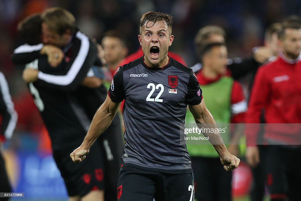 Amir Abrashi of Albania celebrates at full time during the UEFA EURO 2016 Group A match between Romania and Albania at Stade des Lumieres on June 19, 2016 in Lyon, France.