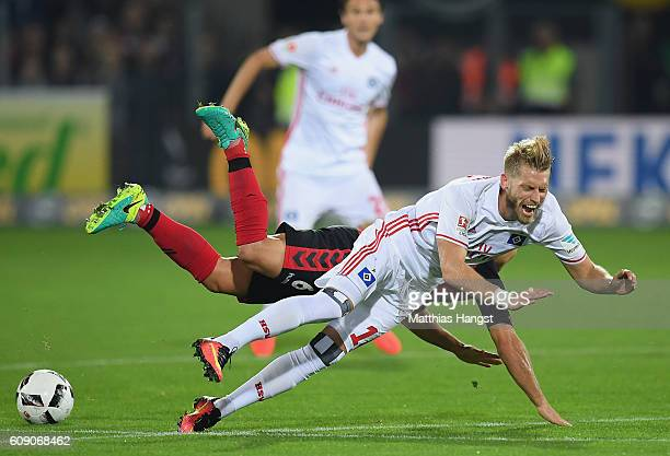 Amir Abrashi of Freiburg is challenged by Aaron Hunt of Hamburg during the Bundesliga match between SC Freiburg and Hamburger SV at...
