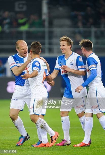 Amir Abrashi of Grasshopper Club celebrates scoring the winning goal with teammates during the Swiss Super League match between FC St Gallen and...
