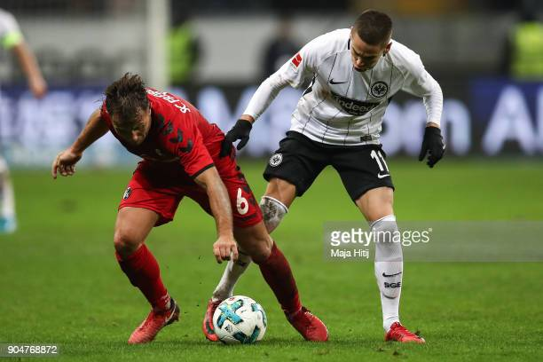 Amir Abrashi of SC Freiburg and Mijat Gacinovic of Eintracht Frankfurt battle for the ball during the Bundesliga match between Eintracht Frankfurt...