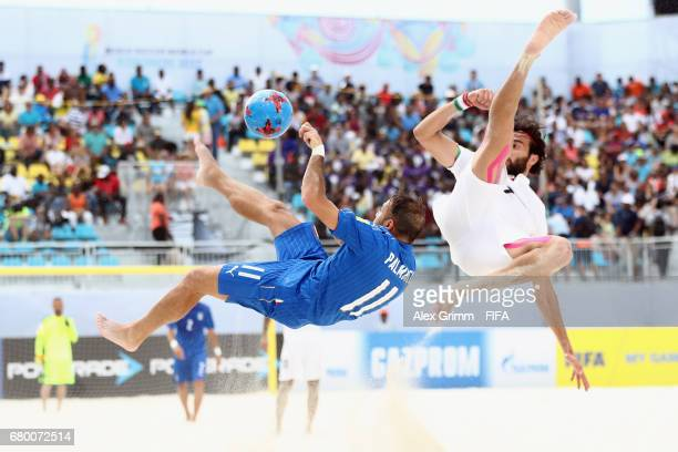 Amir Akbari of Iran blocks a bicycle kick from Paolo Palmacci of Italy during the FIFA Beach Soccer World Cup Bahamas 2017 third place playoff match...