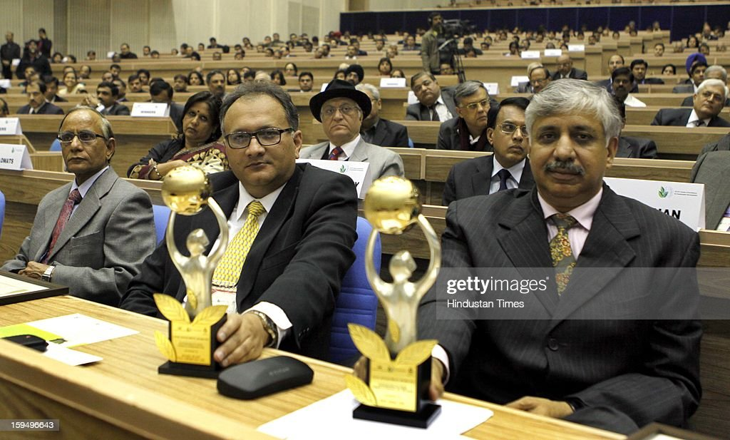 Amir Alvi (C) (Vice President TATA Chemicals Ltd and Chanakya Chaudhary Chief Resident Executive TATA Steel, Delhi with their Awards presented by President Pranab Mukharjee at Vigyan Bhawan on January 14, 2013 in New Delhi, India.
