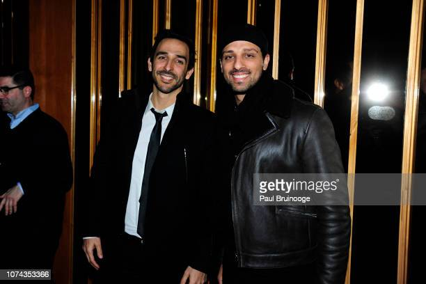 Amir Arison and Ari'el Stachel attend The Cinema Society With FIJI Water Lindt Chocolate Entertainment Weekly People Host The After Party For...