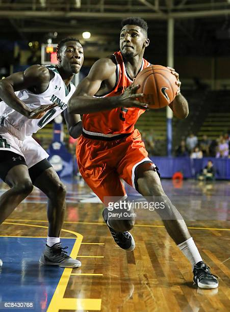 Amir Bell of the Princeton Tigers gets past Leland Green of the Hawaii Rainbow Warriors during the second half of the Pearl Harbor Invitational NCAA...