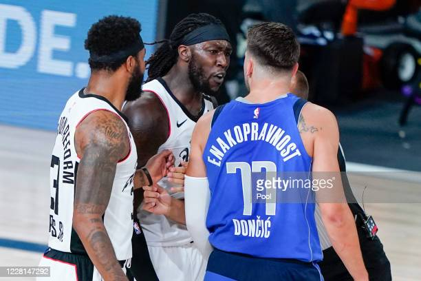Amir Coffey of the LA Clippers and Luka Doncic of the Dallas Mavericks exchange words during the first half of Game Three of first round playoffs at...