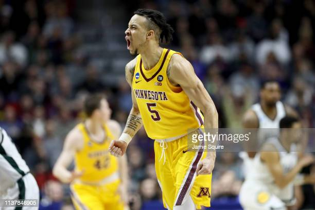 Amir Coffey of the Minnesota Golden Gophers celebrates a basket against the Michigan State Spartans during the first half in the second round game of...