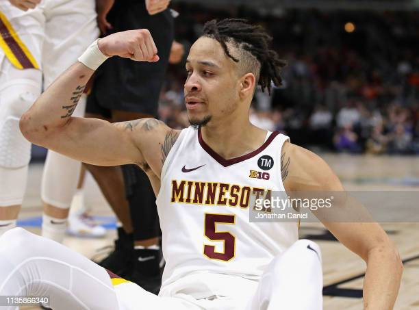 Amir Coffey of the Minnesota Golden Gophers celebrates after hitting a shot and being fouled against the Penn State Nittany Lions at the United...