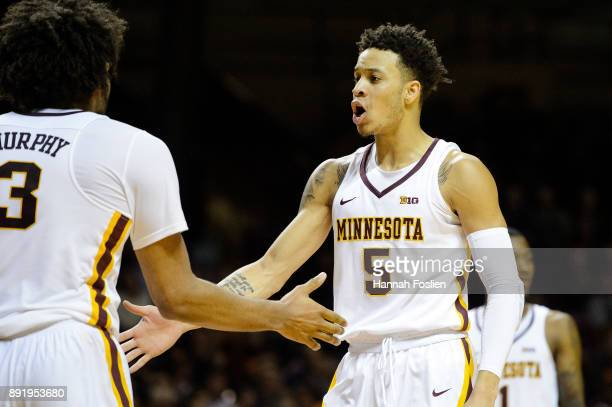 Amir Coffey of the Minnesota Golden Gophers congratulates teammate Jordan Murphy on a basket against the Drake Bulldogs during the game on December...