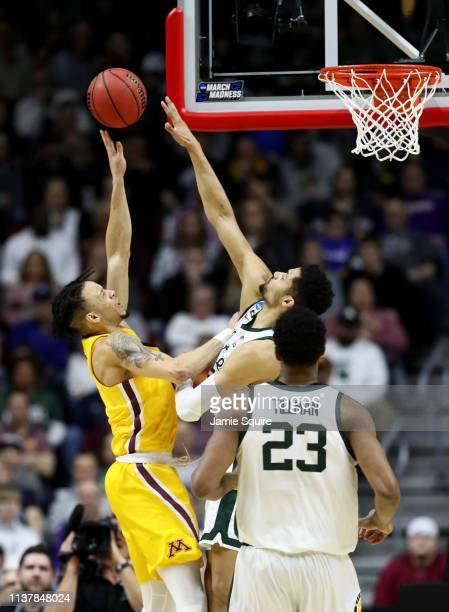Amir Coffey of the Minnesota Golden Gophers shoots the ball against the Michigan State Spartans during the first half in the second round game of the...