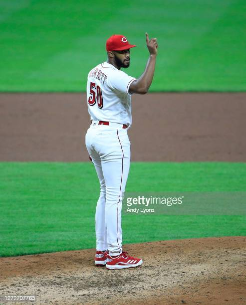 Amir Garrett of the Cincinnati Reds celebrates following the final out of the 4-1 win against the Pittsburgh Pirates at Great American Ball Park on...