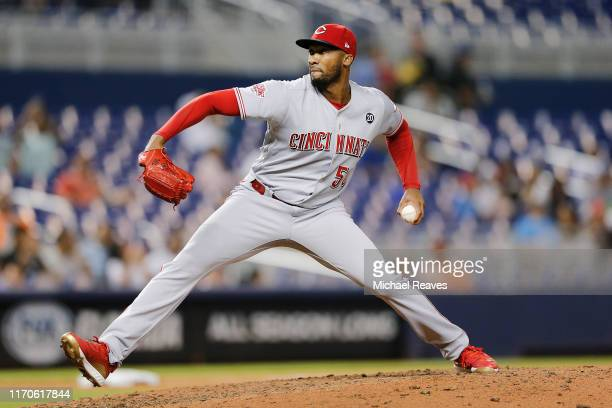 Amir Garrett of the Cincinnati Reds delivers a pitch in the eighth inning against the Miami Marlins at Marlins Park on August 27, 2019 in Miami,...