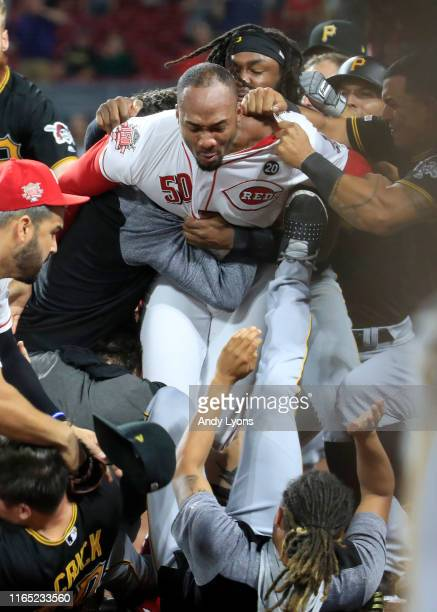 Amir Garrett of the Cincinnati Reds engages members of the Pittsburgh Pirates during a bench clearing altercation in the 9th inning of the game at...