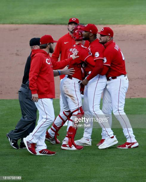 Amir Garrett of the Cincinnati Reds is restrained by teammates during a bench clearing incident in the eighth inning against the Chicago Cubs at...