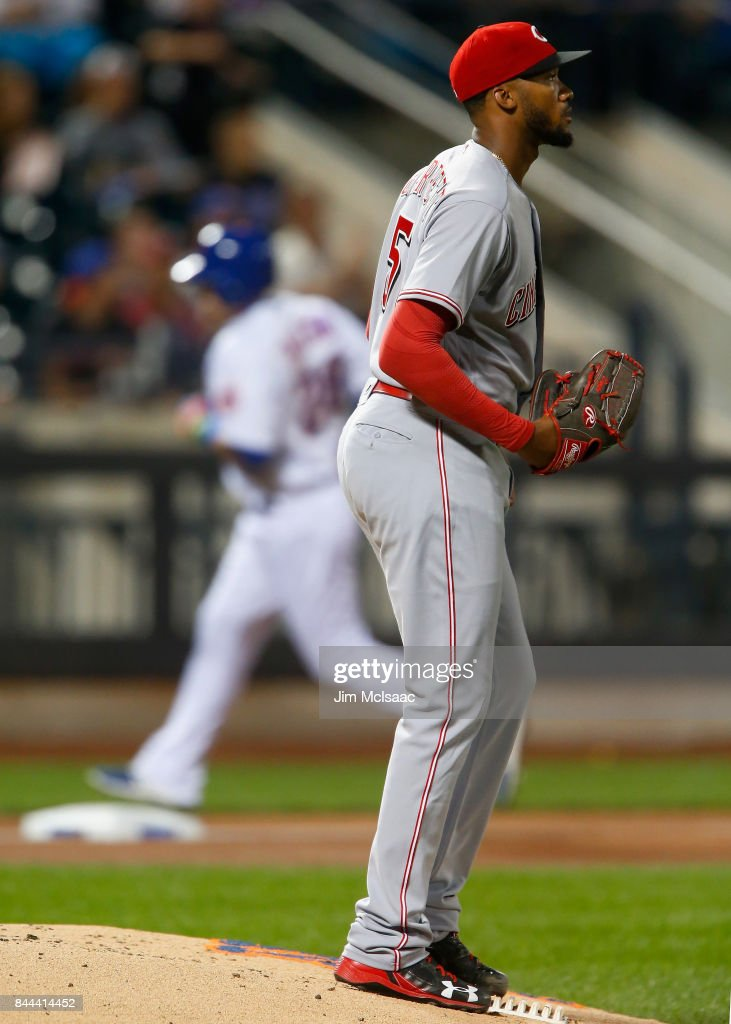 Amir Garrett #50 of the Cincinnati Reds looks on after surrendering a second inning home run against Travis Taijeron #28 of the New York Mets at Citi Field on September 8, 2017 in the Flushing neighborhood of the Queens borough of New York City.